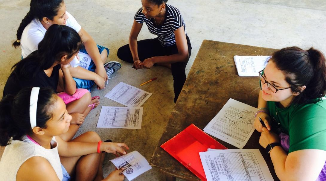 Local girls learn about the importance of healthy diets from a student doing a Nutrition internship abroad in Samoa.